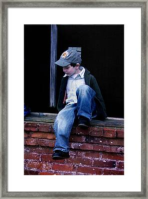 Framed Print featuring the photograph Boy In Window by Kelly Hazel