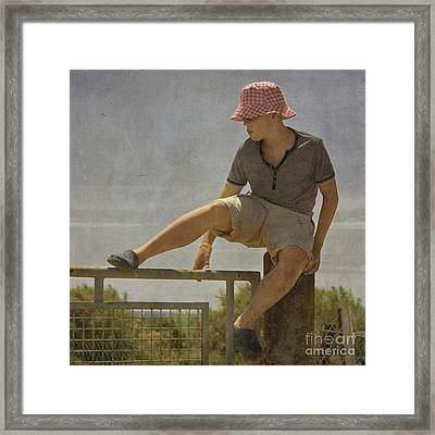 Boy On A Fence Waiting For Lance Armstrong Framed Print by Paul Grand