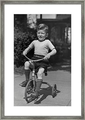 Boy On Tricycle Framed Print by George Marks