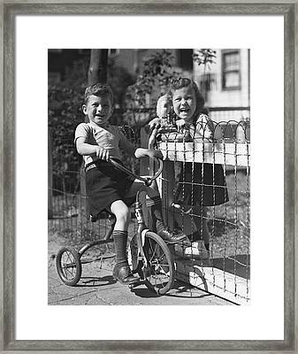 Boy On Tricycle W/ Girl Framed Print by George Marks