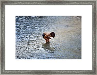 Boy Playing In The Pond Framed Print by Mary Machare