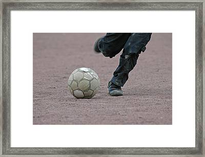 Boy Playing Soccer With A Ball Framed Print