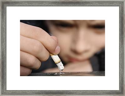 Boy Playing With A Cigarette Framed Print by Andy Harmer