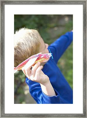 Boy Playing With A Toy Aeroplane Framed Print