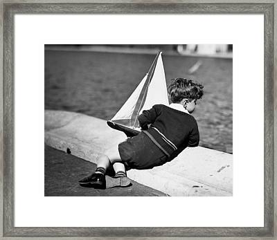 Boy Playing With Toy Sailboat Framed Print by George Marks