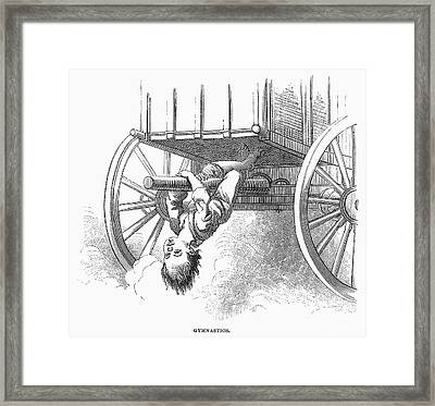 Boy Riding Under Wagon Framed Print by Granger