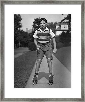 Boy Roller-skating Framed Print by George Marks