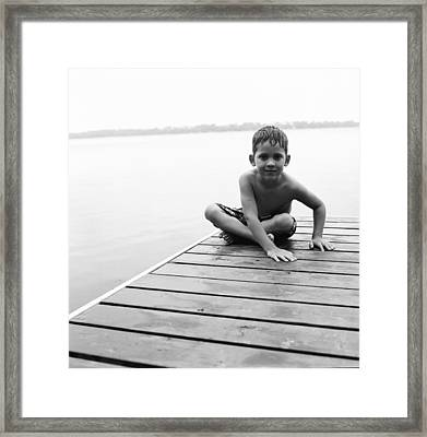 Boy Sitting On Dock Framed Print by Michelle Quance