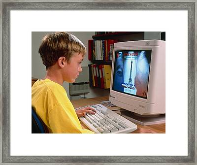 Boy Using A Multimedia Computer To Learn French Framed Print