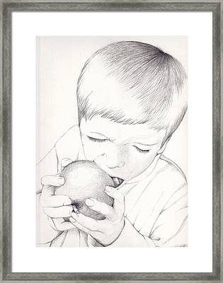 Framed Print featuring the photograph Boy With Apple by Kelly Hazel