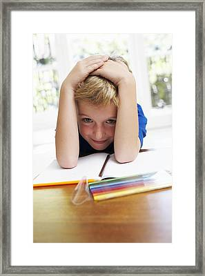 Boy With Pens And Exercise Book Framed Print by Ian Boddy