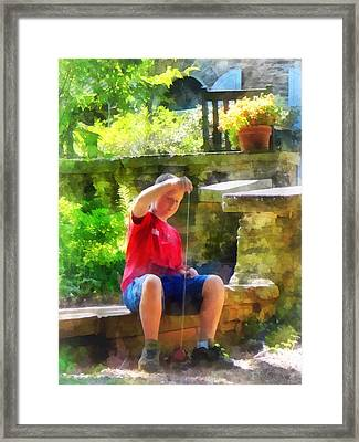 Boy With Yoyo Framed Print by Susan Savad