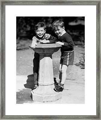 Boys At Drinking Fountain Framed Print by George Marks
