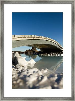 Bridge Over The Blue Lagoon Framed Print by Andres Leon