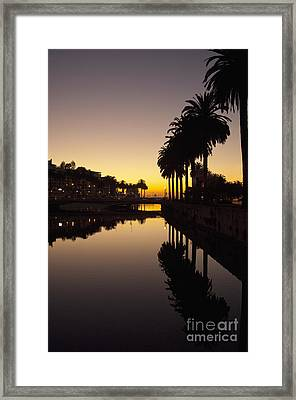 Bridge Over Waterway At Sunset Framed Print by Thom Gourley/Flatbread Images, LLC