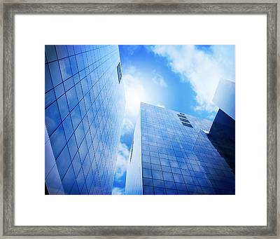 Bright Blue City Buildings With Clouds Framed Print by Angela Waye