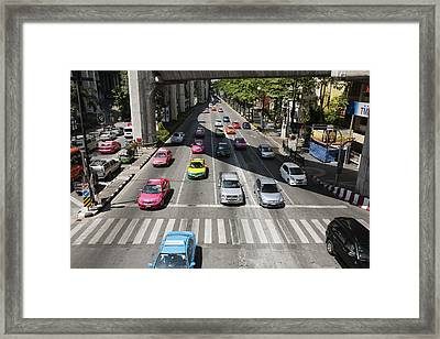 Bright Colored Taxis Mix With Other Framed Print by Roberto Westbrook