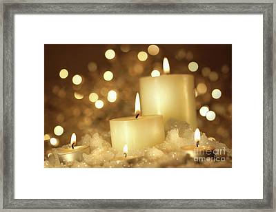 Brightly Lit Candles In Wet Snow Framed Print by Sandra Cunningham