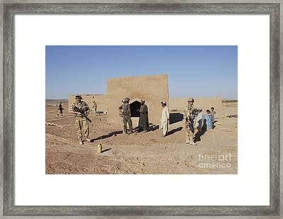 British Soldiers On Foot Patrol Framed Print by Andrew Chittock