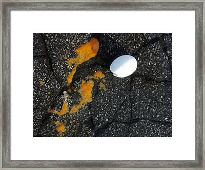 Broken White Egg And Orange Yolk On Black Ground Framed Print by Matthias Hauser