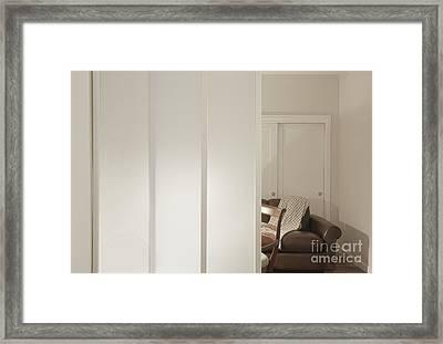 Brown Leather Sofa Seen Through Open Door Framed Print by Andersen Ross