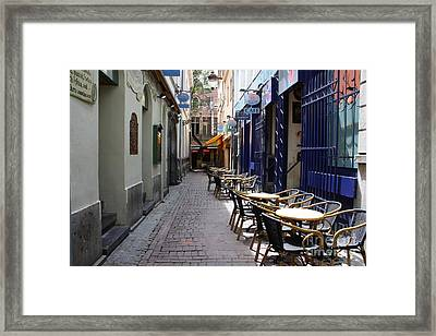 Brussels Side Street Cafe Framed Print by Carol Groenen