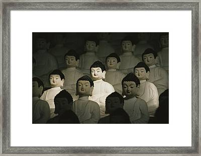 Buddha Statues In The Cave Temple Framed Print by Martin Gray