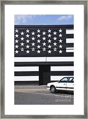 Building With An American Flag Paint Job Framed Print by Paul Edmondson