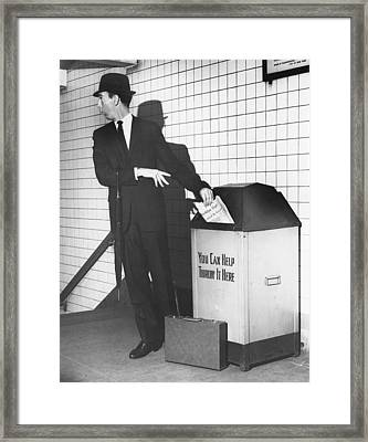 Business Man Tossing Newspaper Framed Print by George Marks