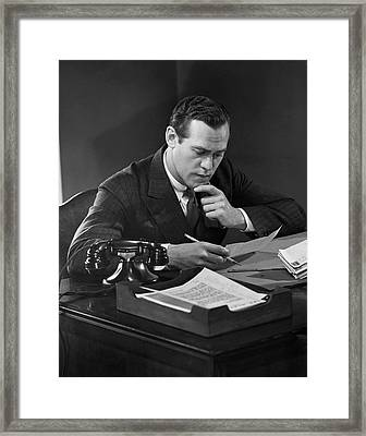 Businessman At Desk Framed Print by George Marks