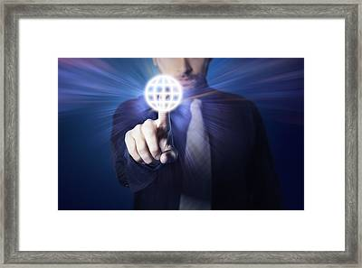 Businessman Pressing Touch Screen Button Framed Print by Setsiri Silapasuwanchai