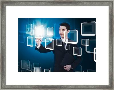 Businessman Pressing Touchscreen Framed Print by Setsiri Silapasuwanchai