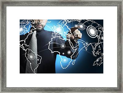 Businessman Touching World Map Screen Framed Print by Setsiri Silapasuwanchai