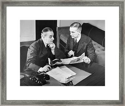 Businessmen Having A Meeting Framed Print by George Marks