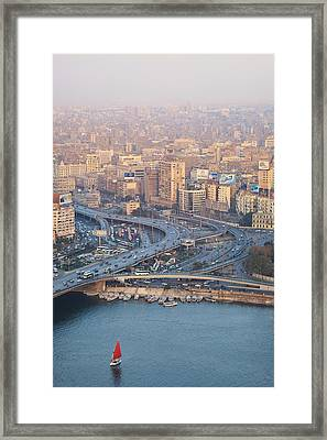 Busy Junction And The Nile With Traditional Boat Framed Print by Kokoroimages.com