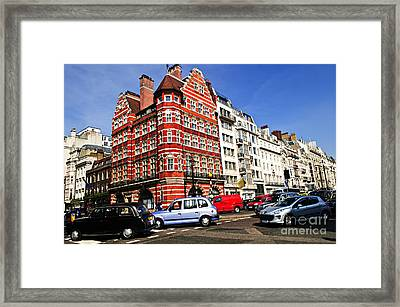 Busy Street Corner In London Framed Print