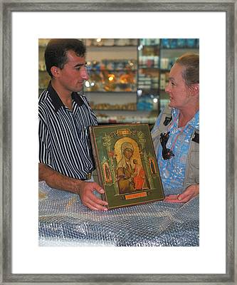 Buying Icon In Jerusalem Framed Print by Carl Purcell