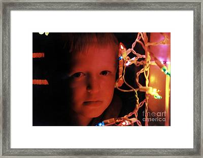 By The Glow Of Christmas Lights Framed Print