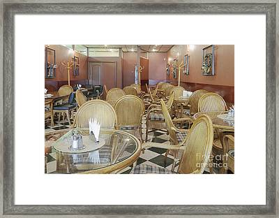 Cafe With Rattan Chairs And Tables Framed Print