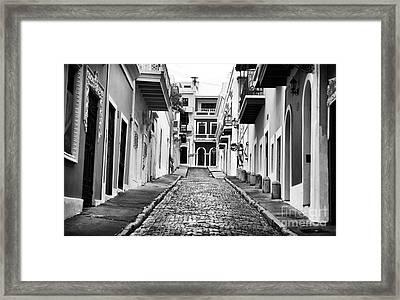 Calle De Guijarro Framed Print by John Rizzuto