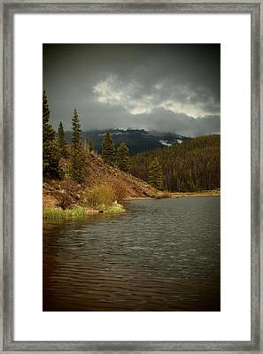 Calm Before The Storm Framed Print by Joyce Specht