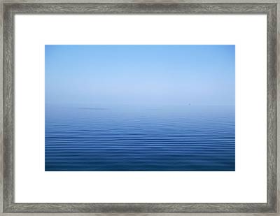 Calm Blue Water Disappearing Into Framed Print by Axiom Photographic