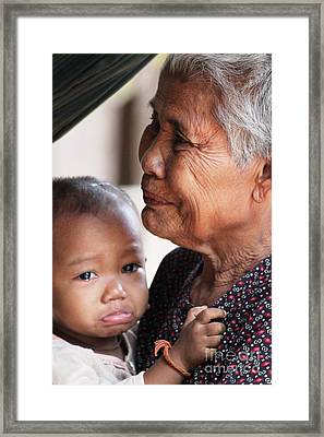 Framed Print featuring the photograph Cambodian Grandmother And Baby #1 by Nola Lee Kelsey
