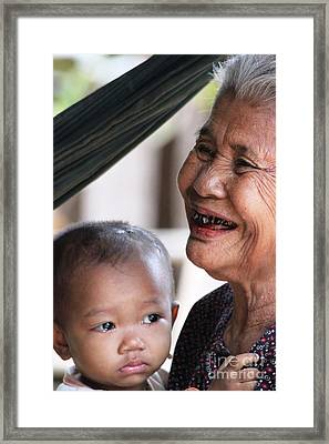 Framed Print featuring the photograph Cambodian Grandmother And Baby #2 by Nola Lee Kelsey