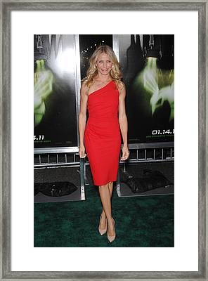 Cameron Diaz Wearing An Azzaro Dress Framed Print by Everett