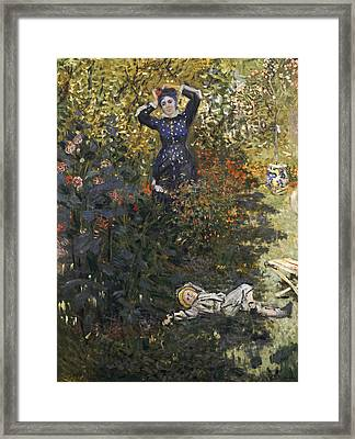 Camille And Jean In The Garden At Argenteuil  Framed Print by Claude Monet