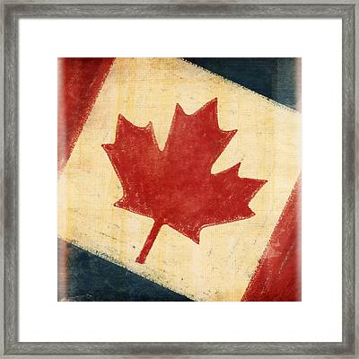 Canada Flag Framed Print by Setsiri Silapasuwanchai