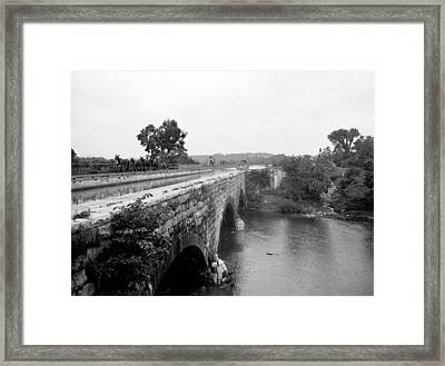 Canal Boat Passing Through An Aqueduct Framed Print