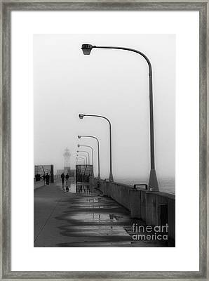 Canal Park Lighthouse In Fog Framed Print by Mark David Zahn