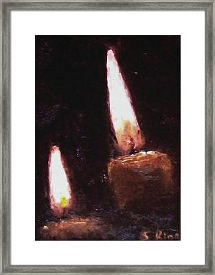 Candle Glow Framed Print